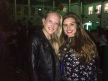 Deafie Blogger on the left wearing a leather jacket and smiling with Rachel Shenton on the right also smiling wearing a floral black and pink top.