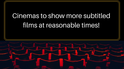 Movie theatre black screen with red chairs in rows facing it. Text on screen says 'cinemas to show more subtitled films at reasonable times'