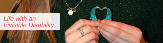 Image banner of a close up holding my hearing aids in a heart shape near my heart and text to the left saying 'Life with an Invisible Disability'