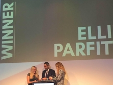 Me on the stage collecting my award from Mark, with Pip Tomson on the right, my name in big on the big screen behind 'winner'