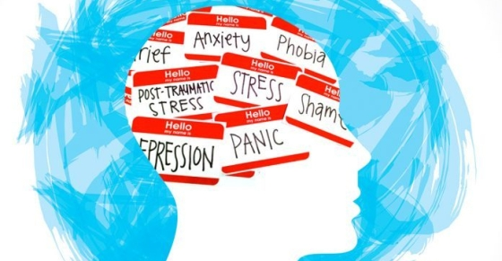 A white illustration of a side portrait of someone's head with a blue messy background. In the brain side of the head it says anxiety, phobia, PTSD, stress, etc