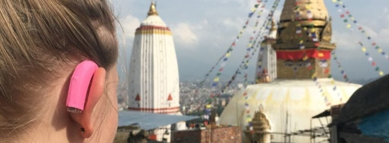 Close up photo of my hearing aid by a temple in Nepal